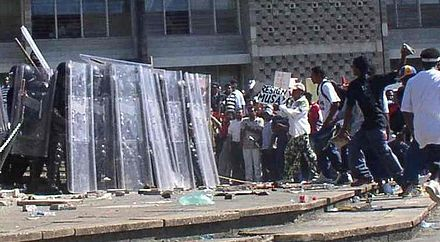 Riot police and protesters during the unrest in 2005. BelmopanDisturbance21Jan05-croppedagain.jpg
