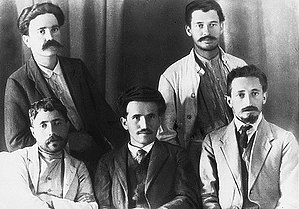 Yosef Haim Brenner - Right to left; seated – Yitzhak Ben-Zvi, David Ben-Gurion, Yosef Haim Brenner; standing – A. Reuveni, Ya'akov Zerubavel (1912)