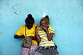 Best friends sit together at the Honiara Central Market. (10677030504).jpg