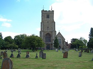 Stone church surrounded by graves