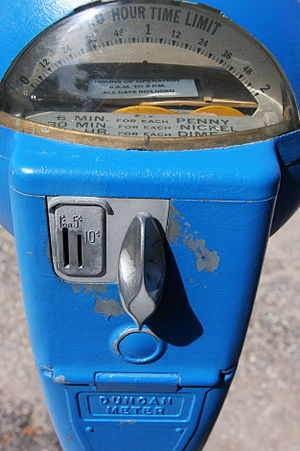 Parking meter - A fully mechanical Duncan brand parking meter which accepts U.S. pennies, nickels, and dimes