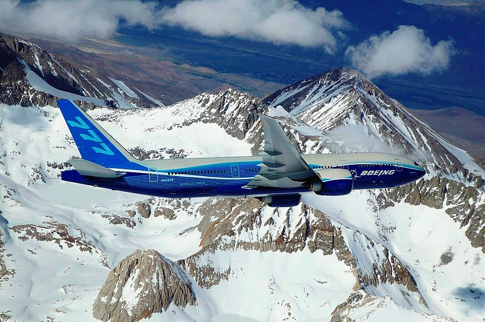 Boeing 777-200LR banking over mountain