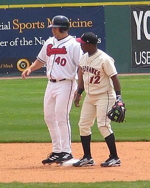 Brad Nelson - Nelson being held at second base by Esteban Germán
