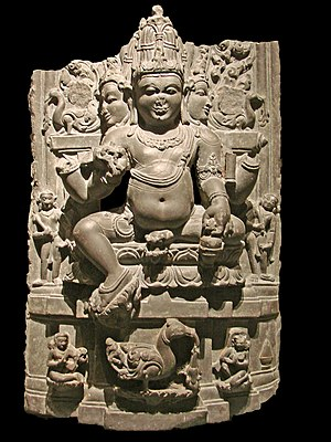 Kamandalu - Brahma holding a kamandalu in his right hand