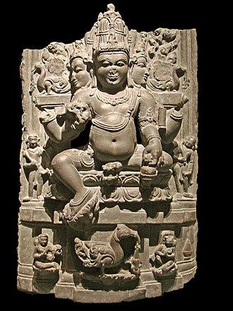 Kamandalu - Brahma holding a kamandalu in his right hand