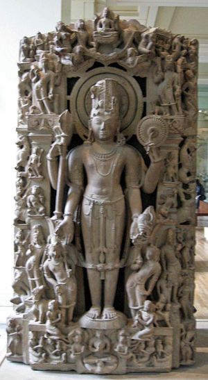 Harihara - Harihara sculpture, British Museum. The left half represents Shiva (with the Trishula) and the right half represents Vishnu (with the Chakra and Conch).