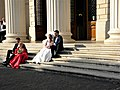 Bucharest, Romania. Bride couple on the steps of Romanian Athenaeum (2017).jpg