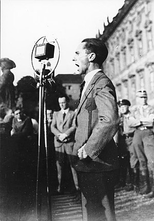 Goebbels speaking at a political rally against...