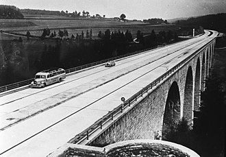 Bundesautobahn 9 - Rudolphstein Saale Bridge in the 1930s, graced by a Mercedes-Benz touring coach. The bridge was later destroyed at the end of the war but rebuilt due to a West and East German cooperation until 1966. The river marked the inner German border