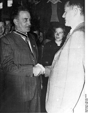 Wehrwirtschaftsführer - Albert Speer (right) congratulates Wehrwirtschaftsführer Edmund Geilenberg (left) on the bestowal of 'Ritterkreuz des Kriegsverdienstkreuzes' (May 1944), photo from the Bundesarchiv (National archive of Germany)