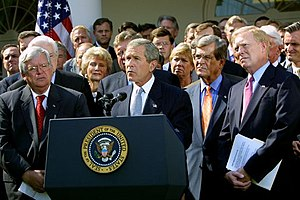 Legitimacy of the 2003 invasion of Iraq - President George Bush, surrounded by leaders of the House and Senate, announces the Joint Resolution to Authorize the Use of United States Armed Forces Against Iraq, October 2, 2002.