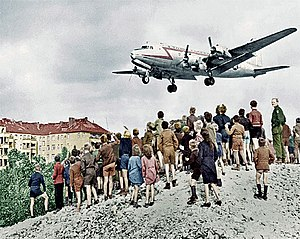 Douglas C-54 Skymaster - A C-54 landing at Tempelhof airport during the Berlin Airlift.