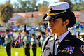Cadet Capt. Joanna Chua, Troy High School Navy Junior Reserve Officer Training Corps cadet commanding officer, bows her head during the invocation for the Veterans Day Parade at Fullerton, Calif., Nov. 12 121112-A-GT718-017.jpg