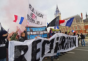 "Radical right (Europe) - French radical right protesters in Calais hold banners saying ""Reimmigrate"" and ""Diversity is a code word for white genocide"", 8 November 2015"