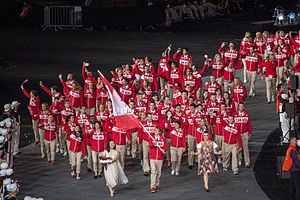 2012 Summer Olympics and Paralympics cauldron - The Canadian Olympic team entering the stadium with a girl carrying Canada's petal for the cauldron.