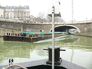 Canal Saint-Denis - A barge under the Pont de Flandre in Paris