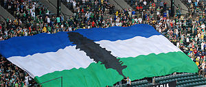 Doug flag - The flag being carried by fans at a Portland Timbers game in Portland, Oregon in 2010