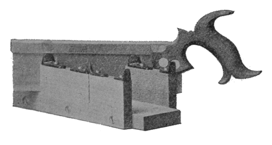 Cc&j-fig17--mitre box with dovetail saw.png
