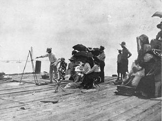 Charles Webster Hawthorne - Webster (left) teaches an outdoor class, 1910