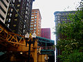 Chicago Loop buildings and El station.jpg