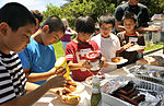 Children from Chatan town visit Kadena, interact with American children 150723-F-QQ371-219.jpg