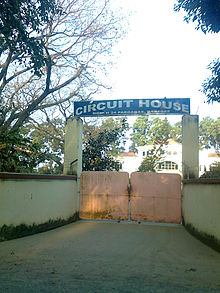 "Closed gate with an arch reading ""Circuit House"""