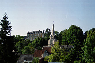 Larçay - The church tower and the manor house, in Larçay
