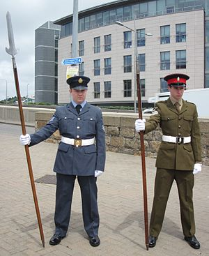 Combined Cadet Force - Cadets during commemorations in Jersey 2013. Showing the RAF Section uniform (left) and Army Section uniform (right)