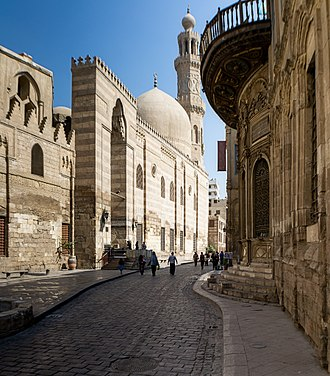 Muizz Street - One of the most iconic sections of Muizz Street known as Bayn al-Qasrayn, featuring Mosque-Madrassa of Sultan Barquq on the left and Sabil of Muhammad Ali Pasha on the right.