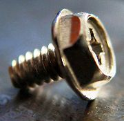 Combination flanged-hex/Phillips-head screw used in computers