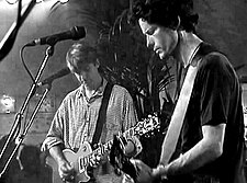 Crowded House playing live in Cafe De Kroon, Amsterdam, June 1996. Left: Neil Finn, right: Mark Hart