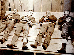 Banditry - Members of the Dalton Gang following the Battle of Coffeyville in 1892. Left to right: Bill Power; Bob Dalton; Grat Dalton and Dick Broadwell.