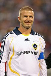 f3f2408e1eb Beckham (with a blue captain s armband) became LA Galaxy captain  immediately upon joining the team