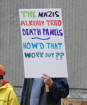 Protest sign: The Nazis already tried death pa...