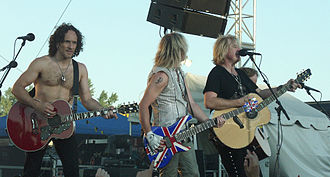 Glam metal - Four Def Leppard songs were on the top ten of the Billboard Hot 100.