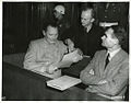 Defendants Göring, Dönitz, and Hess conferring Nuremberg Trials.jpeg