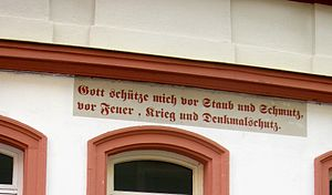 "Deutsche Stiftung Denkmalschutz - ""God save me from dust and dirt, from fire, war, and the Denkmalschutz"" on a building in Bamberg"