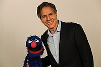 "Deputy Secretary Blinken Poses for a Photo With Sesame Street's ""Grover"" (29796240865).jpg"