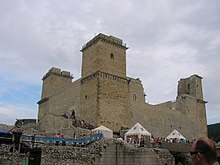A fortress with four towers, surrounded with a moat