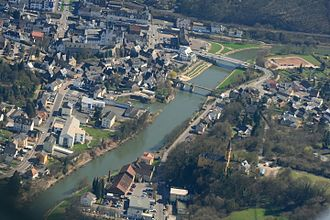 Diez, Germany - Historic city center with old (front) and new Lahn Bridge and Lock (upper left)