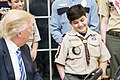 Donald Trump shares a laugh with a member of the Boy Scouts of America, March 2017.jpg