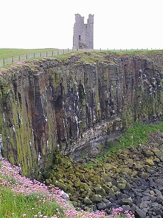 Dunstanburgh Castle - The Gull Crag cliffs and Lilburn Tower