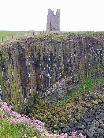 The Gull Crag cliffs and Lilburn Tower Dunstanburgh Castle and Whin Sill - geograph.org.uk - 109789.jpg