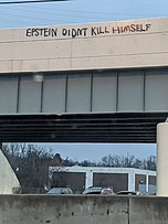 Graffiti on a bridge over a highway
