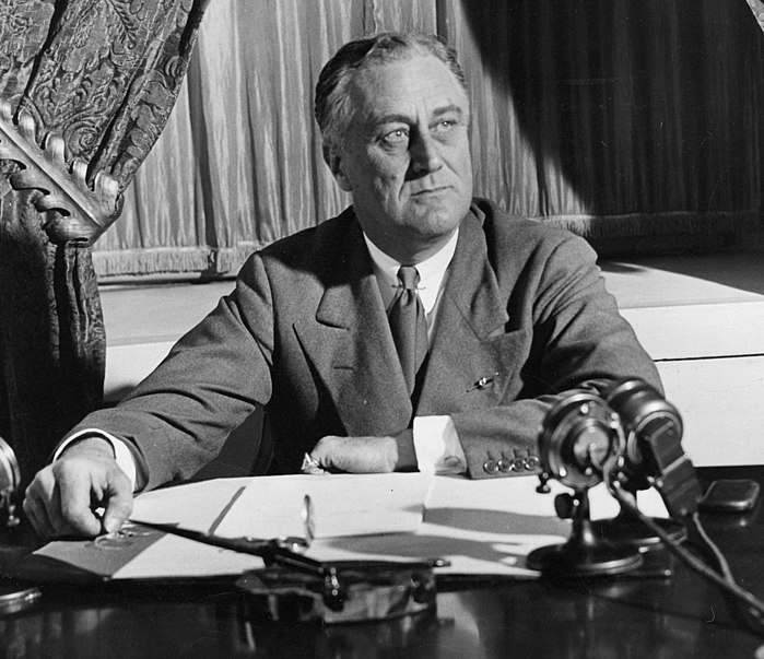 FDR at his desk with microphones