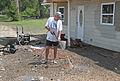 FEMA - 30619 - Man cleaning sidewalk in Missouri with pressure washer.jpg
