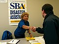 FEMA - 30747 - SBA worker shakes hands with FCO in South Dakota.jpg