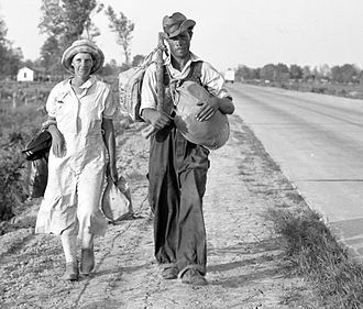 Crittenden County, Arkansas - Cotton workers on the road, carrying all they possess in the world. Crittenden County, Arkansas, 1936.
