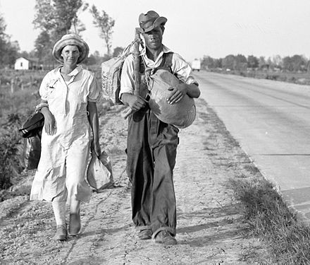 Cotton workers on the road, carrying all they possess in the world. Crittenden County, Arkansas, 1936. Farm workers, Crittenden County, Arkansas.jpg