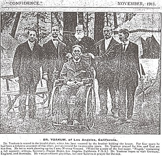 Pisgah Home Historic District - Finis Yoakum posing in wheelchair with former invalid following healing, Nov. 1911